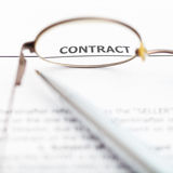 Sales contract through eyeglasses. View of sales contract through eyeglasses close up Royalty Free Stock Photography