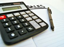 Sales count. Using a calculator to count sales in business royalty free stock photos
