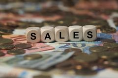 Sales - cube with letters, money sector terms - sign with wooden cubes Stock Photos