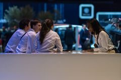 Sales delegates at the end of the day, Geneva International Motor Show 2018 royalty free stock photography
