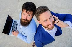 Sales department work as team. Entrepreneurship as teamwork. Businessmen with laptop and phone call solving problems royalty free stock photo