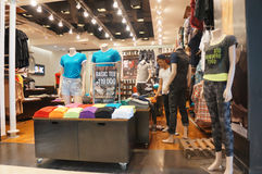 Sales discount. Various types of clothing sold at a discount shopping mall in the city of Solo, Central Java, Indonesia Stock Photos