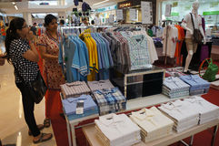 Sales discount. Various types of clothing sold at a discount shopping mall in the city of Solo, Central Java, Indonesia Stock Photo