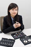 Sales girl4. A sales girl was introducing her makeup products Stock Images