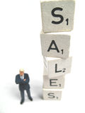 Sales going up. A sales manager standing next to the word sales stock images