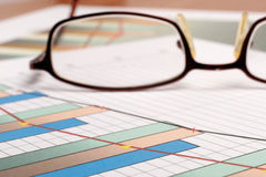 Sales graph and glasses Stock Photos