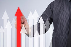 Sales Growth Graph - Businessman hand pressing button on touch s Royalty Free Stock Photo