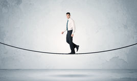 Sales guy balancing on tight rope Royalty Free Stock Images