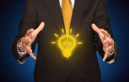 Sales guy has bright idea in the hand Royalty Free Stock Photos