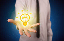Sales guy has bright idea in the hand Royalty Free Stock Images