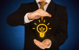 Sales guy has bright idea in the hand Royalty Free Stock Photography
