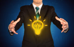 Sales guy has bright idea in the hand Royalty Free Stock Photo
