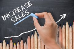 Sales increase concept or target on chalkboard with wave of colored pencils. Sales increase target on chalkboard with wave of colored pencils Stock Photography