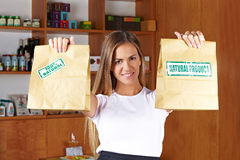 Sales lady holding paper bags Stock Photos
