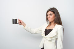 Sales lady holds a product on palm Royalty Free Stock Photos