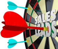 Sales Leads Dart Board Selling Prospects Customers. Sales Leads words on a dart board to illustrate selling to prospects and finding new customers for a business Royalty Free Stock Images
