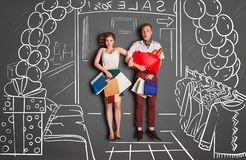During sales. Love story concept of a romantic couple on shopping against chalk drawings background. Young couple with shopping bags entering a shopping mall stock illustration