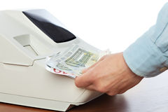 Sales man holding cash in payment for purchases in the store Royalty Free Stock Photos