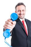 Sales man showing telephone to the camera Stock Image