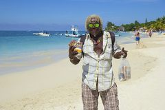Sales man in West Bay beach in Honduras, Caribbean Stock Images