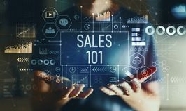 Sales 101 with man. Sales 101 with young man in the night royalty free stock photography