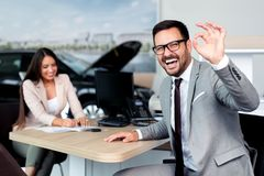 Free Sales Manager At A Showroom Car Is Worth To The Buyer Stock Image - 123704751