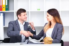 Sales manager giving advice to his couple clients.  stock image