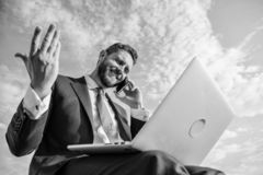Sales manager responsibilities. Stay in touch. Man formal suit work with laptop while speak on phone. Businessman. Surfing internet while speaking to client stock photo
