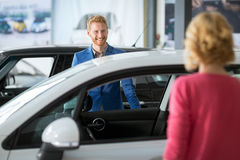 Sales manager at a showroom car with costumer Stock Photos
