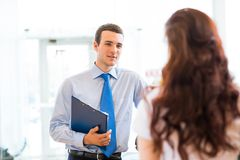 Sales manager at a showroom car Royalty Free Stock Photo