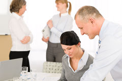Sales meeting business people discussing Stock Image