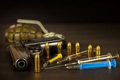 Sales of narcotics. Weapon and drugs on the table. Handgun and ammunition. Stock Images