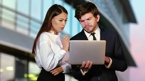 Sales people working on a laptop outside. stock footage
