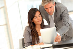Sales people working with tablet Royalty Free Stock Image