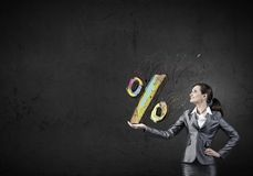 Sales and percentage. Young businesswoman holding percentage symbol in palm Stock Images