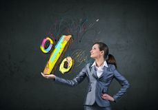 Sales and percentage. Young businesswoman holding percentage symbol in palm Stock Photos