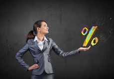 Sales and percentage. Young businesswoman holding percentage symbol in palm Royalty Free Stock Images