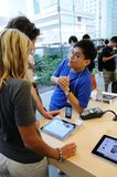 Sales person and customer in Apple store Stock Photography