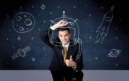 Sales person drawing helmet and space rocket Royalty Free Stock Photography