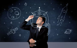 Sales person drawing helmet and space rocket Royalty Free Stock Images