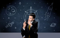 Sales person drawing helmet and space rocket Stock Photos