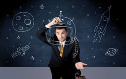 Sales person drawing helmet and space rocket Royalty Free Stock Photo