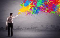 Sales person painting colorful splatter Royalty Free Stock Image