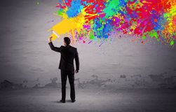 Sales person painting colorful splatter Stock Photography
