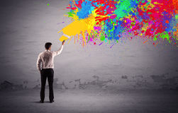Sales person painting colorful splatter Royalty Free Stock Images