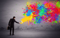 Sales person painting colorful splatter Royalty Free Stock Photography