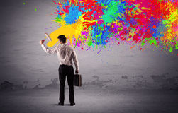Sales person painting colorful splatter Stock Images