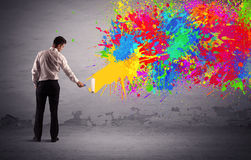 Sales person painting colorful splatter Royalty Free Stock Photo