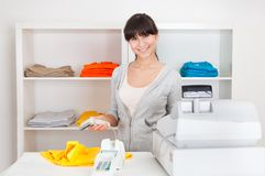 Sales person in the shop Royalty Free Stock Photo