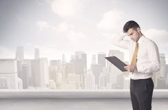 Sales person talking in front of city scape Stock Photo